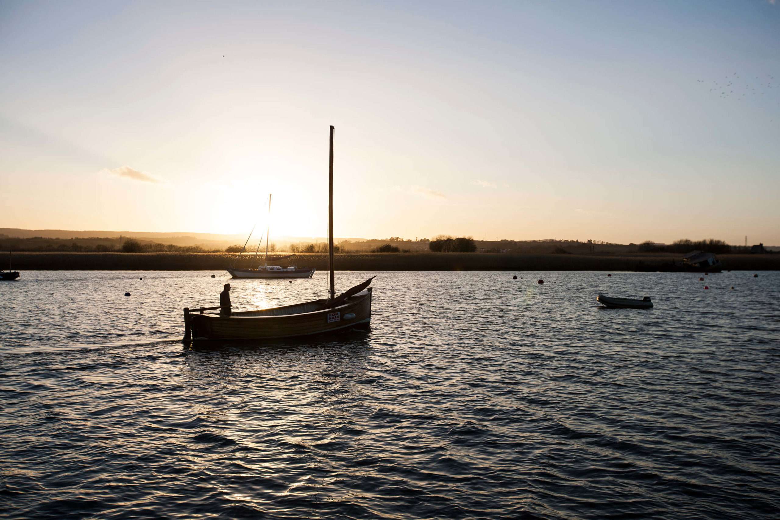 Fisherman returns home on the River Exe, Exeter