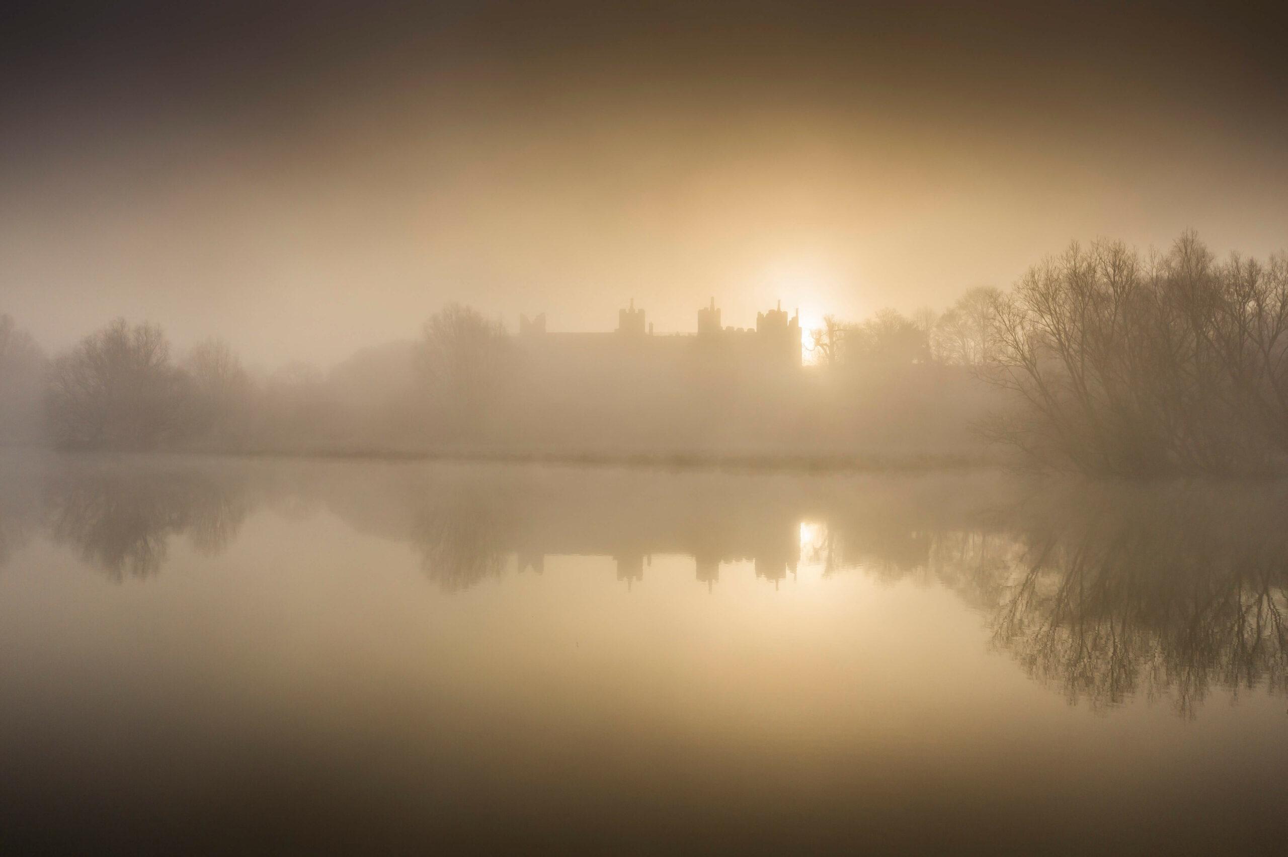 Framlingham Castle emerges from the morning mists
